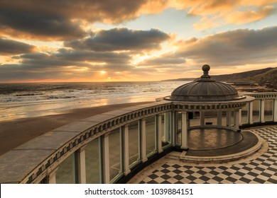 SCARBOROUGH, ENGLAND - FEBRUARY 24: Sun rises over sea and Scarborough Spa bandstand. In Scarborough, England. On 24th February 2018.
