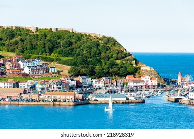 Scarborough, North Yorkshire, England - August 24, 2014: View over Scarborough South Bay harbor.The town has fishing and service industries and is the largest holiday resort on the Yorkshire coast,UK