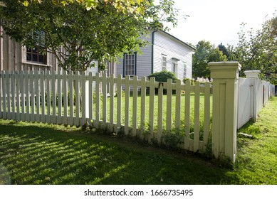 Scarborough, Ontario / Canada - Sept 12, 2014 :   exterior with white picket fence. Scarbourgh, Ontario, Canada.