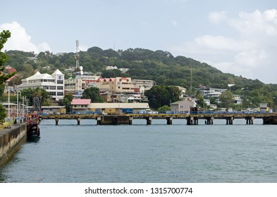 SCARBOROUGH, TRINIDAD AND TOBAGO - JANUARY 11, 2019:  Waterfront and pier at Scarborough on a cloudy afternoon.