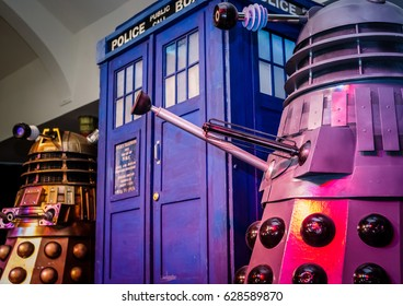Scarborough, UK - April 08, 2017: Dalek models and the Tardis from the tv series 'Doctor Who' at the Sci-Fi Scarborough convention.