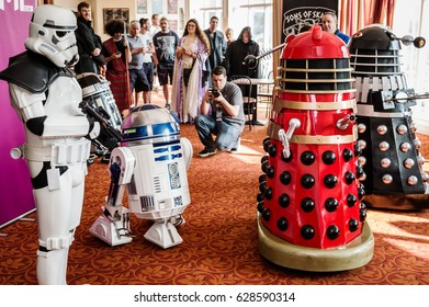 Scarborough, UK - April 08, 2017: People dressed as a 'Stormtrooper' and 'Daleks' encounter an R2-D2 model at Sci-Fi Scarborough convention,