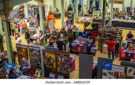Scarborough, UK - April 09, 2017: Merchandise stalls at Sci-Fi Scarborough with Daleks in the background.