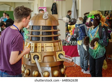 Scarborough, UK - April 09, 2017: Cosplayer and a Dalek interact in one of the halls at Sci-Fi Scarborough.