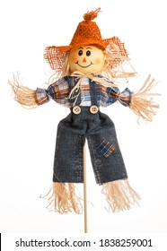 Scarecrow doll. Autumn decorations. Country style. Isolated on white background