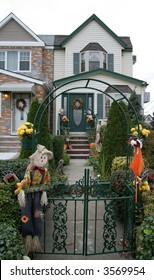 A scarecrow in front of house