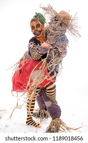 Scarecrow and human pumpkin dancing together