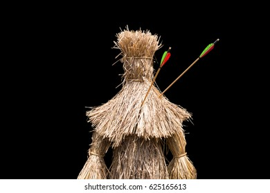 A scarecrow was shot by arrows. Isolated on black background.