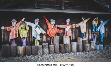 Scarecrows on strike. These are Japanese scarecrows having a demonstration, looking fierce, having opinions, protecting the farm. Taken in Shirakawago.