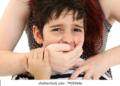 Scared 8 year old boy being abused or abducted by adult female.