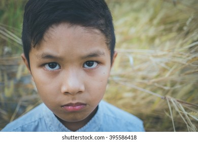 scared and alone, young Asian child, selective focus, vintage colour