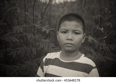 scared and alone, young homeless Asian child who is at high risk of bing bullied, trafficked and abused