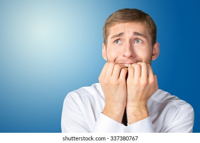 Scared and astonished young businessman