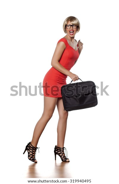 scared beautiful blonde with short hair and a laptop bag