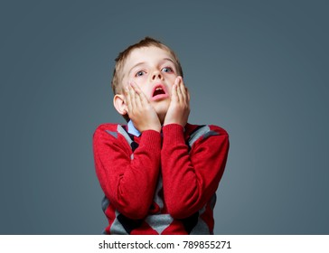 scared boy isolated against grey background
