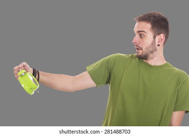 Scared guy holding green alarm