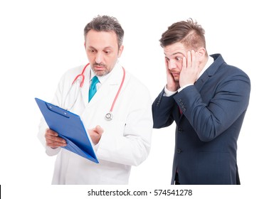 Scared lawyer and his doctor analyzing medical results from clipboard on white background