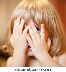 Scared little girl, shallow DOF, focus on eye
