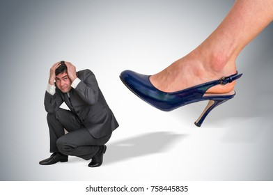 Scared and shocked small businessman under boss pressure