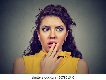 Scared shocked woman isolated on gray background