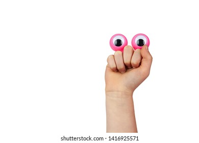 Scared but smiling funny cartoonish face made by googly eyes and childs hand isolated on white background with copy space