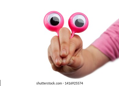 Scared and surprised but funny cartoonish character face  made with child hand and googly eyes isolated on white background with copy space