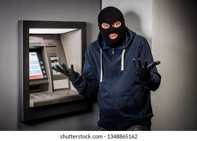 scared thief with ATM. people and emotions concept.