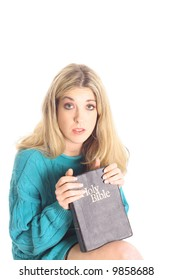 scared woman holding a bible