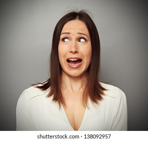 scared woman looking at something at screaming