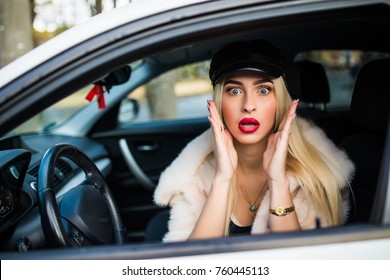 scared woman shouts driving the car - outdoors