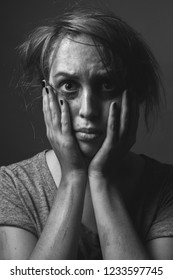 Scared  woman with smeared make up. Black and white