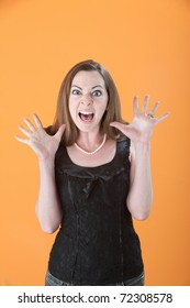 Scared Young Caucasian woman on an orange background