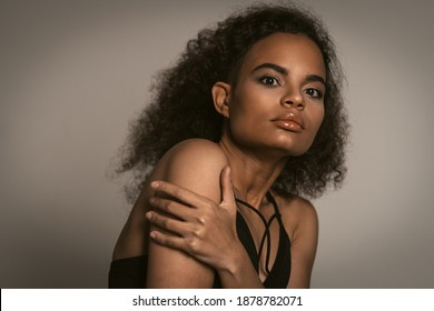 Scared young girl covering herself with her hands. Stop violence against Women. Women violence and abused concept. trafficking Concept. - Shutterstock ID 1878782071