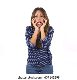 Scared young woman wearing blue blouse isolated on white background