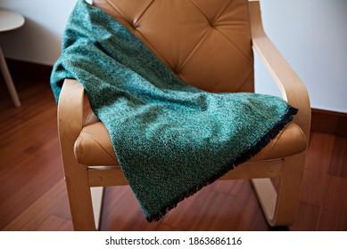 Scarf on a leather sofa