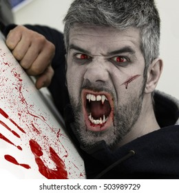 Scaring human transforming into a vampire with blood