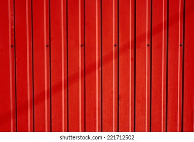 Scarlet corrugated metal fence as a background