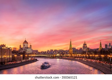 Scarlet glow of the sunset over the Moscow River and the Kremlin