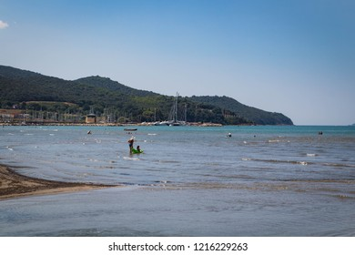 SCARLINO, ITALY - JULY 24, 2018 - Beautiful bay: sea and beach, hills and marina on background