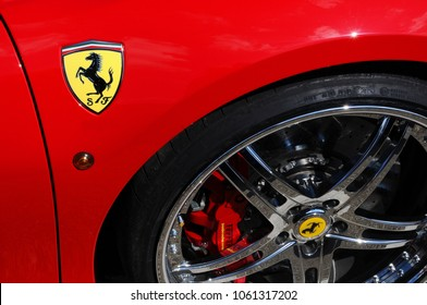 Scarperia (Florence), Italy - March 2018 : Ferrari Logo on Sport Car in the paddock of Mugello Circuit. Ferrari S.P.A. is an Italian luxury sports car manufacturer, founded by Enzo Ferrari.
