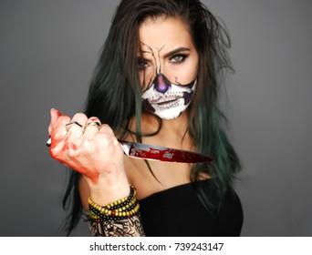 Scarry halloween skull make up girl studio selective focus