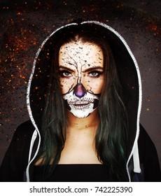 Scarry halloween skull make up girl ember background