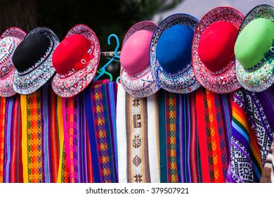 scarves and hats in a market in Peru