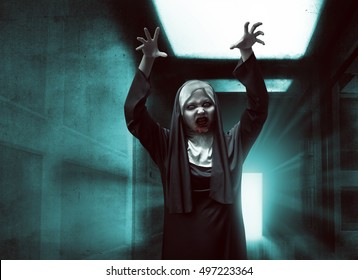 Scary asian nun with bloody mouth raise up hand want to scare