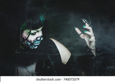 scary assasin undead woman with finger claw studio shot