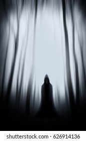 scary cloaked figure ghost in haunted Halloween forest background