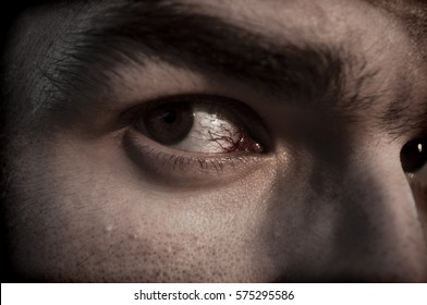 Scary closeup of a tired man's eye