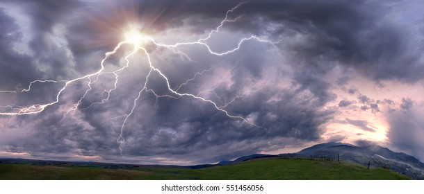 Scary clouds scenic natural phenomena in a cloud of black and white shades and dazzling colors - clouds after rain and bad weather in the storm with lightning over the mountains