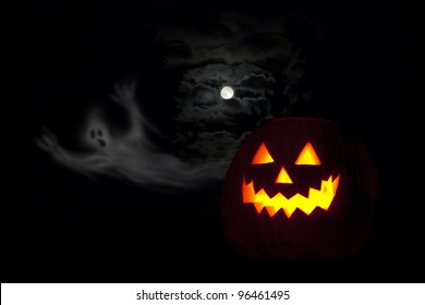 A scary collection of eerie moon, ghost and Jack o' lantern on a frightening night.