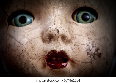 Scary cracked old doll face, shallow focus